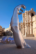 """""""The Awakening"""" a 70 ft sculpture aluminuim sculpture by Seward Johnson - Duomo square, Syracuse ( Siracusa) , Sicily .<br /> <br /> Visit our SICILY PHOTO COLLECTIONS for more   photos  to download or buy as prints https://funkystock.photoshelter.com/gallery-collection/2b-Pictures-Images-of-Sicily-Photos-of-Sicilian-Historic-Landmark-Sites/C0000qAkj8TXCzro<br /> If you prefer to buy from our ALAMY PHOTO LIBRARY  Collection visit : https://www.alamy.com/portfolio/paul-williams-funkystock/syracusesicily.html"""