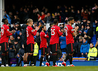 Football - 2019 / 2020 Premier League - Everton vs. Manchester United<br /> <br /> Manchester United players Aaron Wan-Bissaka, Brandon Williams, Odion Ighalo and Bruno Fernadnes applaud their travelling fans at the final whistle, at Goodison Park.<br /> <br /> COLORSPORT/ALAN MARTIN