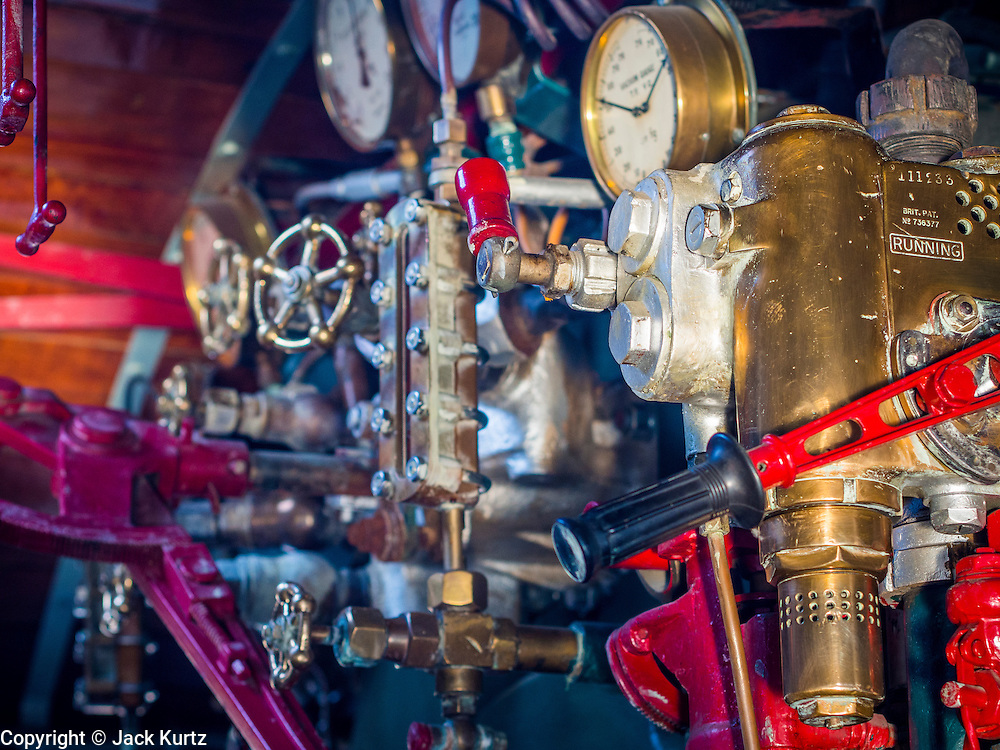 """05 DECEMBER 2013 - BANGKOK, THAILAND:  The controls of a steam engine train put into service for the 86th birthday of Bhumibol Adulyadej, the King of Thailand. Dec. 5, the King's Birthday, is a national holiday in Thailand, and is also celebrated as the country's """"Fathers' Day."""" The State Railways of Thailand put on special trains to take people to the King's """"Summer Palace"""" in the oceanside community of Hua Hin where the King granted a public audience. There were also merit making ceremonies throughout the country.  Many people wear yellow on the King's Birthday because yellow is the color associated with his reign. As of 2013, he was the longest reigning monarch in the world.          PHOTO BY JACK KURTZ"""