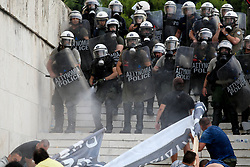 June 16, 2018 - Athens, Greece - Police spray demonstrators with mace during a protest against the agreement between Greece and Macedonia over the dispute of the former Yugoslav's republic name. Greek lawmakers on Saturday debated for a final day on a no-confidence motion against the government over a deal to end a decades-old dispute with neighboring Macedonia over the latter's name. (Credit Image: © Aristidis Vafeiadakis via ZUMA Wire)