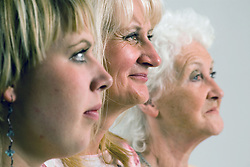 Three generations of women; in profile,