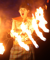 Members of ScotlandÕs pioneering Celtic Fire Theatre company, PyroCeltica, in full Highland Warrior apparel with flaming claymores and fire staffs perform on Edinburgh Castle Esplanade ahead of leading a torchlit procession down the Royal Mile during Edinburgh Hogmanay celebrations.