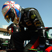 Minardi's new British driver Anthony Davidson parks on the grid and climbs out before the start as he prepares for his F1 debut