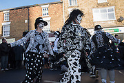 PIG DYKE MOLLY DANCERS, The Straw Bear Festival, Whittlesey,Peterborough. 17 January 2016<br /> On Plough Tuesday, the day after Plough Monday (the first Monday after Twelfth Night), a man or boy is covered from head to foot in straw and led around the town where  he would dance in exchange for gifts of money, food or beer. The custom was was resurrected by the Whittlesea Society in 1980.