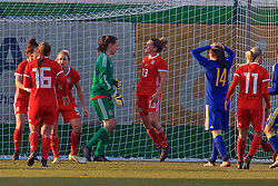 ZENICA, BOSNIA AND HERZEGOVINA - Tuesday, November 28, 2017: Wales' goalkeeper Laura O'Sullivan celebrates with Rachel Rowe after saving an 84th minute penalty from Bosnia and Herzegovina's Milena Nikolić during the FIFA Women's World Cup 2019 Qualifying Round Group 1 match between Bosnia and Herzegovina and Wales at the FF BH Football Training Centre. (Pic by David Rawcliffe/Propaganda)