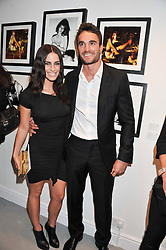 THOM EVANS and JESSICA LOWNDES at a private view of Human Relations featuring the photographs of Fenton Bailey and Mairi-Luise Tabbakh, curated by Sascha Bailey held at Imitate Modern, 27a Devonshire Street, London, W1 on 1st May 2013.