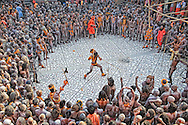 Hundreds of Naga Sadhus gathered in the compound of Maya Devi Temple, befoe going in a procession to take a holy dip in the ganges. <br /> <br /> Sadhus gather here and perform all kind of feats, to show off their warrior skills, with their weapons, which include sticks, tridents, swords and spears.<br /> <br /> Kumbh Mela, 2010, Haridwar, Uttarakhand.