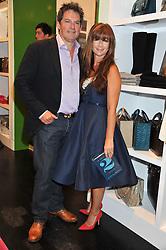 DEBORAH LLOYD Creative Director of Kate Spade and her husband SIMON ARSCOTT at the opening of the Kate Spade New York Store, 2 Symons Street, London on 1st September 2011.