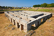 Base of a Roman Temple ( 200 BC) in  Paestum dedicated to the Capitoline Triad, Jupiter, Juno and Minerva, in the Roman Forum. Paestum archaeological site, Italy. .<br /> <br /> If you prefer to buy from our ALAMY PHOTO LIBRARY  Collection visit : https://www.alamy.com/portfolio/paul-williams-funkystock/paestum-greek-temples.html<br /> Visit our CLASSICAL WORLD HISTORIC SITES PHOTO COLLECTIONS for more photos to buy as buy as wall art prints https://funkystock.photoshelter.com/gallery-collection/Classical-Era-Historic-Sites-Archaeological-Sites-Pictures-Images/C0000g4bSGiDL9rw