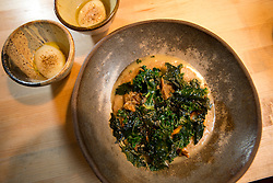 O Chanterelle and farro spezzato with poached egg, preserved lemon and braising greens, at The Progress restaurant, Tuesday, Dec. 15, 2015, in San Francisco, Calif. (Photo by D. Ross Cameron)