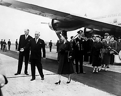 Princess Elizabeth with American President Harry S. Truman after her arrival with the Duke of Edinburgh at Washington D.C. Behind President Truman is the Canadian Ambassador Mr Hume Wrong.