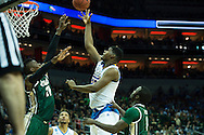 21 MAR 2015: Tony Parker (23) of the University of California - Los Angeles shoots over Tosin Mehinti (21) of the University of Alabama - Birmingham during the 2015 NCAA Men's Basketball Tournament held at the KFC Yum! Center in Louisville, KY. UCLA defeated UAB 92-75. Brett Wilhelm/NCAA Photos