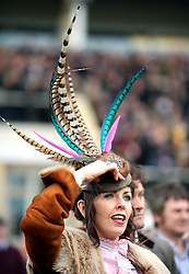 A female racegoer watches the action from the RSA Insurance Novices' Chase during Ladies Day of the 2018 Cheltenham Festival at Cheltenham Racecourse.