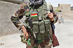 © Licensed to London News Pictures. 30/06/2014. Khanaqin, UK Khanaqin, Iraq. The equipment of a young Kurdish peshmerga is seen in Jalawla, Iraq. Counted by Kurds as part of their homeland, fighting in the town of Jalawla now consists of occasional skirmishes and exchanges of fire between snipers and heavy machine guns on both sides.<br /> <br /> The peshmerga, roughly translated as those who fight, is at present engaged in fighting ISIS all along the borders of the relatively safe semi-automatous province of Iraqi-Kurdistan. Though a well organised and experienced fighting force they are currently facing ISIS insurgents armed with superior armament taken from the Iraqi Army after they retreated on several fronts. Photo credit : Matt Cetti-Roberts/LNP