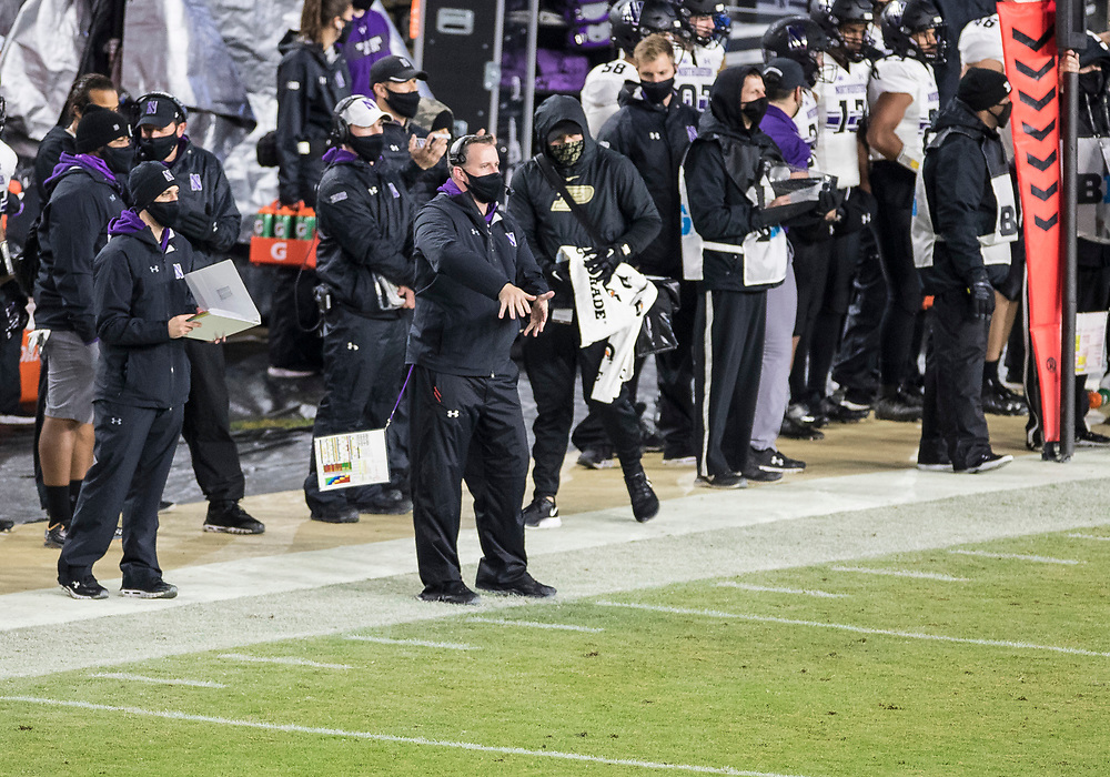 November 14, 2020:  Northwestern head coach Pat Fitzgerald motions intentional grounding during NCAA football game action between the Northwestern Wildcats and the Purdue Boilermakers at Ross-Ade Stadium in West Lafayette, Indiana. Northwestern defeated Purdue 27-20.  John Mersits/CSM.
