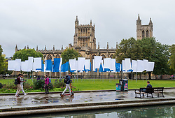 """© Licensed to London News Pictures; 01/10/2021; Bristol, UK. Artist Luke Jerram's work """"In Memoriam"""" has been installed on College Green in front of Bristol Cathedral. The work, made up of over 100 flags which have been made from NHS hospital bed sheets, has been created in memorial to the losses experienced during the COVID-19 pandemic, and is open to the public from 1st – 17th October. Jerram has toured this installation throughout the UK and Europe but now brings it to his hometown of Bristol. Photo credit: Simon Chapman/LNP."""