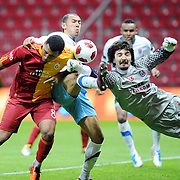 Galatasaray's Colin Kazim RICHARDS (L) and Trabzonspor's goalkeeper Tolga ZENGIN (R), Umut BULUT (C) during their Turkish superleague soccer derby match Galatasaray between Trabzonspor at the TT Arena in Istanbul Turkey on Sunday, 10 April 2011. Photo by TURKPIX