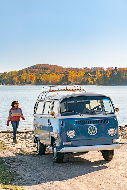 Fall color road trip in a vintage Volkswagen van along the Lake Michigan coast of the Old Mission Peninsula near Traverse City, Michigan.
