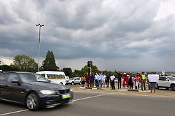 140418 Johannesburg. Winnie Madikizela-Mandela funeral. Storm clouds over crowds singing on the corner of Cedar and Witkoppen roads, Fourways as traffic comes past them. The motorcade would come past this corner to the Fourways Memorial Park where Winnie wil be laid to rest.  Picture: Karen Sandison/African News Agency (ANA)