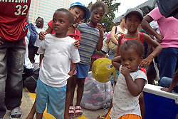28th August, 2005. Hurricane Katrina, New Orleans, Louisiana. A family await shelter in the Superdome.