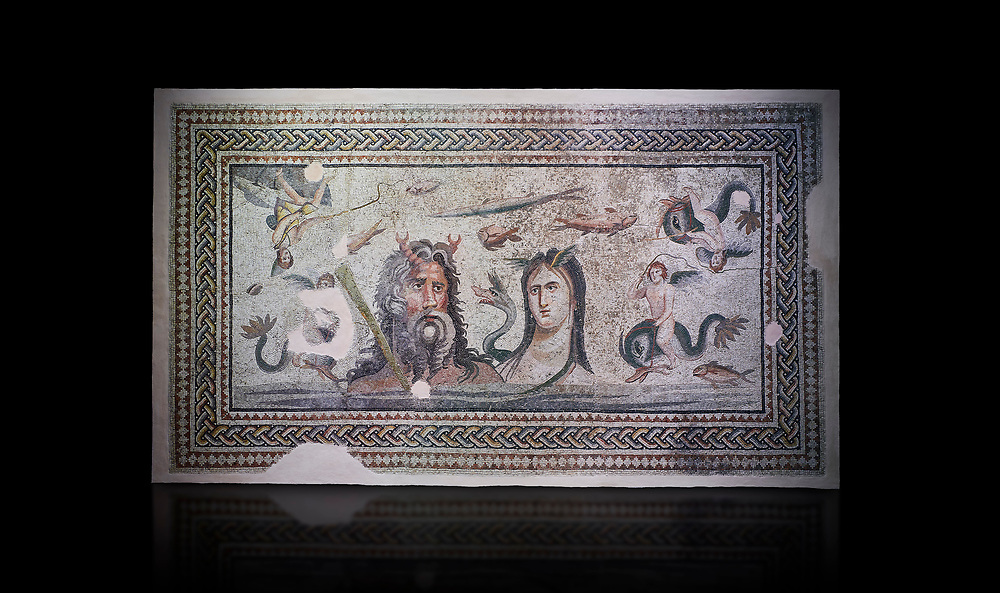 Roman Mosaic - The Oceanos & Tethys Mosaic, fom The House of Oceanos, Zeugma.  2nd - 3rd century AD. Zeugma Mosaic Museum, Gaziantep, Turkey.   Against a black background.<br /> <br /> The Oceanos and Tethys Mosaic is the floor mosaic of the shallow pool of the House of Oceanos. In this mosaic, which belongs to the Early Roman Empire Period, Oceanos, the river god who is the origin of life, and his wife Tethys are represented. At the middle of the mosaic which is surrounded by a geometric triple tress borders there are Oceanos and his wife Tethys. Around them there are Eros figures riding various species of fish and dolphins symbolising the abundance of the sea. The most represented attributes of Oceanos are snake and fish.<br /> <br />  in the mosaic, Oceanos is seen with chelas. Those chelas are among his most characteristic attributes. Though the tail of an eel is represented as his feet in the figures on ceramics, within the scope of the art of mosaic he is represented as a bust and only with the chelas on his head such as this one. His wife Tethys is right by his side and represented with wings upon her forehead. Between them, there is the dragon called Cetos which is a mythological sea creature. As is seen in the coins of Zeugma, the Euphrates River is expressed as a dragon. Besides these two figures, on the top-right of the mosaic, there is a young male figure which is thought to be Pan, the patron of fishermen and shepherds. The fact that Eros figures and Pan which are the side figures are located outward implies that the pool is built to allow walking around. <br /> <br /> The expression of the Oceanos as not an ocean but a river surrounding the world: By that the water, which vapours with the heat of the sun and then gives life to the nature by becoming rain, and which after being used by the nature reaches again the sea via the rivers is expressed. The water becomes aware of itself and its function by that cycle. This phenomenon is represented in the mosa