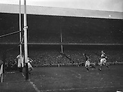 Kerry goalie J Cullotty saves a shot by P. Doherty during the All Ireland Senior Gaelic Football Final Kerry v Down in Croke Park on the 22nd September 1960. Down 2-10 Kerry 0-8.