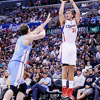15 April 2014: Los Angeles Clippers forward Blake Griffin (32) takes a jump shot over Denver Nuggets center Timofey Mozgov (25) during the Los Angeles Clippers 117-105 victory over the Denver Nuggets at the Staples Center, Los Angeles, California, USA.