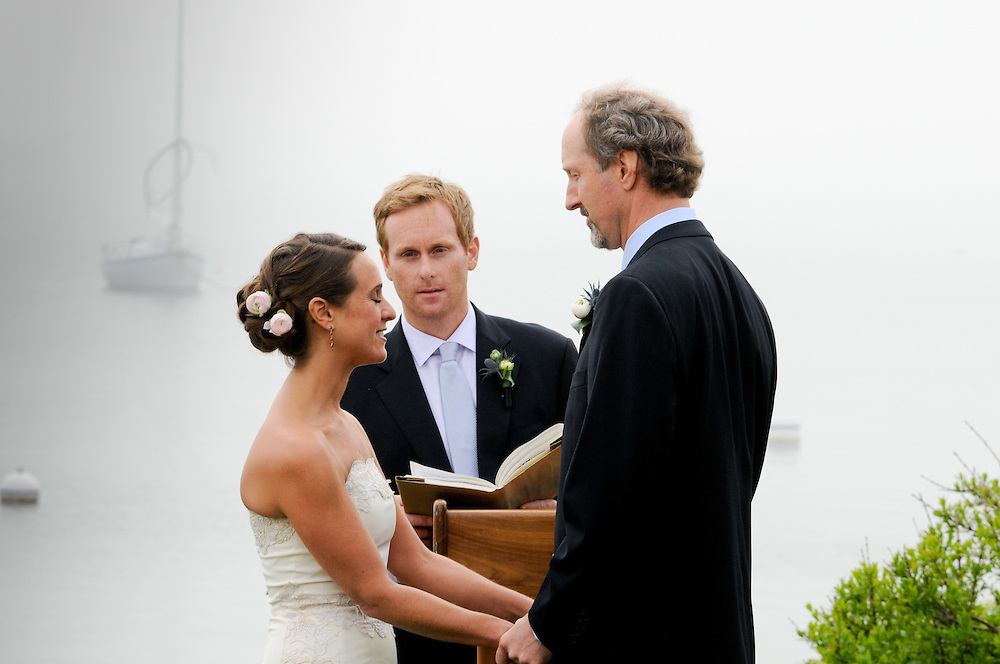 Bride and groom exchange vows at the Eastern Point Yacht Club, Gloucester, MA.