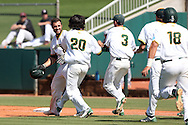 28 May 2016: Teammates rush towards Cal Poly Pomona's Jason Padlo (left) after he drove in the game-winning run. The Cal Poly Pomona Broncos played the Southern Indiana Eagles in Game 2 of the 2016 NCAA Division II College World Series  at Coleman Field at the USA Baseball National Training Complex in Cary, North Carolina. Cal Poly Pomona won the game 2-1 in ten innings.