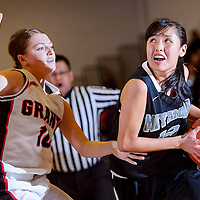 012114       Cable Hoover<br /> <br /> Miyamura Patriot Presleigh Smiley (12) charges past Grants Pirate Lany Elkins (10) Tuesday at Grants High School.