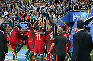 Portugal Manager Fernando Santos is thrown in the air by his players after victory during the Euro 2016 final between Portugal and France at Stade de France, Saint-Denis, Paris, France on 10 July 2016. Photo by Phil Duncan.