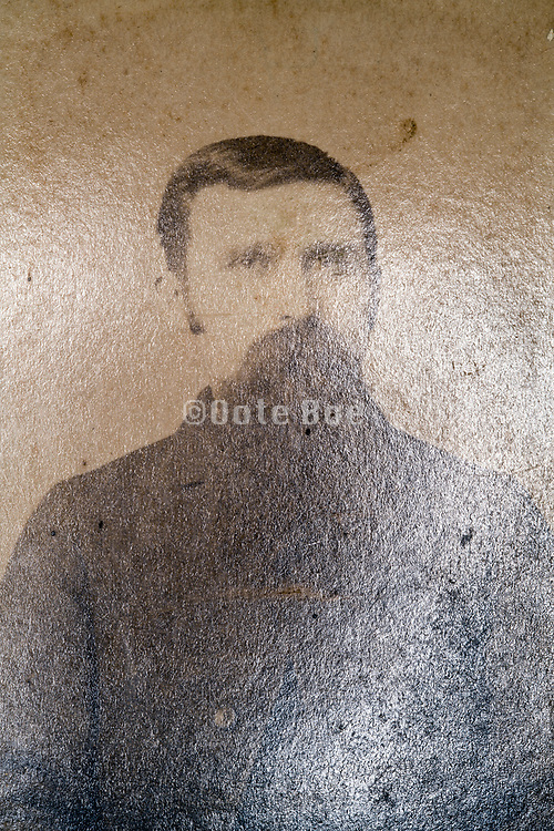 deteriorating early 1900s portrait with adult man