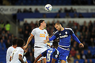 Hull City's Alex Bruce (l) challenges Cardiff City's Matthew Connelly. Skybet football league championship match, Cardiff city v Hull city at the Cardiff city stadium in Cardiff, South Wales on Tuesday 15th Sept 2015.<br /> pic by Carl Robertson, Andrew Orchard sports photography.