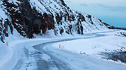 Winding road in winter in the Westfjords of Iceland
