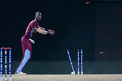 © Licensed to London News Pictures. 05/10/2012. West Indian Darren Sammy looks on as the stumps are broken after a run out attempt during the World T20 Cricket Mens Semi Final match between Australia Vs West Indies at the R Premadasa International Cricket Stadium, Colombo. Photo credit : Asanka Brendon Ratnayake/LNP