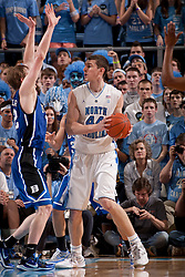 CHAPEL HILL, NC - MARCH 05: Tyler Zeller #44 of the North Carolina Tar Heels looks to pass over Kyle Singler #12 of the Duke Blue Devils on March 05, 2011 at the Dean E. Smith Center in Chapel Hill, North Carolina. North Carolina won 67-81. (Photo by Peyton Williams/UNC/Getty Images) *** Local Caption *** Tyler Zeller;Kyle Singler
