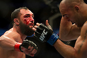 Johny Hendricks throws a punch at Robbie Lawler during UFC 171 at the American Airlines Center in Dallas, Texas on March 15, 2014.
