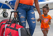 Stacy Jaochim, 2, walks with her mother Marcline Jaochim after they were evacuated from Abaco, Bahamas, in the wake of Hurricane Dorian. The mother and daughter were taken off the hard hit island to Nassau on Monday, September 9, 2019.
