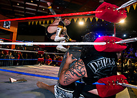 """The """"Master of Mayhem"""" Tommy Mack jumps """"Samoan Storm"""" AFA Jr during the main event """"Street Fight"""" at the Whiskey Barrel's Pro Wrestling Injustice for Brawl event Saturday night to benefit PJ Kearney and Boston Children's Hospital.   (Karen Bobotas/for the Laconia Daily Sun)"""