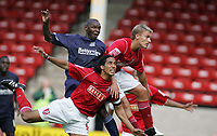 Photo: Paul Thomas.<br /> Walsall v Southend. Coca Cola League 1.<br /> 13/08/2005.<br /> <br /> Shaun Goater climbs high above the Walsall defence to level the scores.