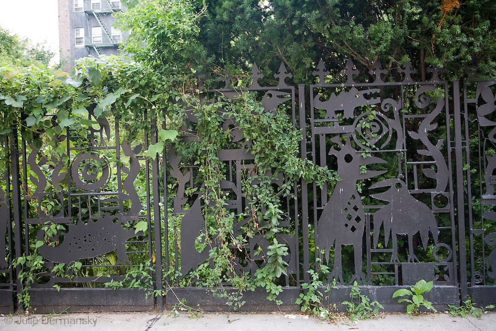 The welded fence at El Sol Brillante, A community owned garden in New York City was created by Julie Dermansky. It is made with scrap metal and is 100 feet long. Dermansky created the fence in 1993. It was her first public art commission.