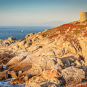 """The remains of the """"Pietra"""" genoese tower on the island of la Pietra in l'Ile-Rousse in Corsica. The sunsets from this spots are stunning."""