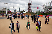 London 2012 Olympic Park in Stratford, East London. Crowds of fans walking around the site.