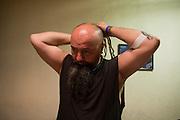 """Srdjan """"Gino"""" Jevdjevic prepares backstage at Gun Club in Belgrade, Serbia..."""