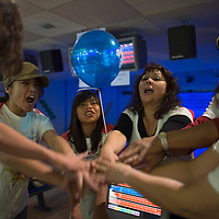 011113      Cayla Nimmo<br /> <br />  Kristen Macapagal, her paired little sister April Lee, Vanessa Duckett, and the other members of team Striking Strikers demonstrates their pride with a cheer to win the Spirit Award during the annual bowling fundraisers for Big Brothers Big Sisters held Saturday at Gal-A-Bowl. The Striking Strikers won the Most Spirited award, which was a hand painted Batman themed bowling pin. <br /> <br /> 4/26/14