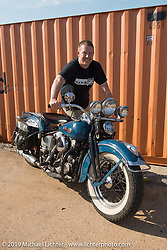 """Jef Pearce with his 1947 Harley-Davidson Knucklehead restored in the 1980s by his wife's uncle Tony. Tony rode this bike that is now called """"Uncle Tony's Bike"""" coast to coast to clear his head after returning from the Vietnam War in the 1960's. Setup day at the Congregation Show in Charlotte, NC. USA. Friday April 13, 2018. Photography ©2018 Michael Lichter."""