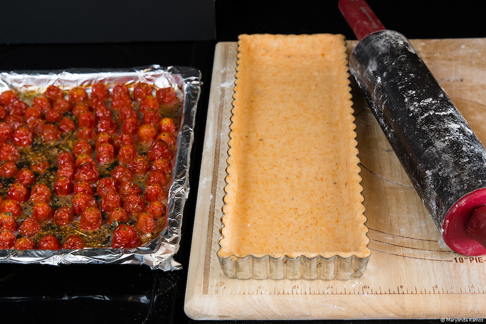Season the grape tomatoes with a mixture of olive oil, oregano, salt and pepper.  For the pastry, smoked paprika, ground mustard and cream cheese add interest without overwhelming the caponata and roasted tomatoes.