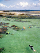 Tourists enjoy their time exploring Green Island and the Great Barrier Reef, off the coast of Cairns, QLD, Australia