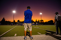 Grant High School Pacers head coach Mike Alberghini, looks on as the sun sets during the first half as the Davis High School Blue Devils host the Grant High School Pacers, Friday Aug 23, 2019.