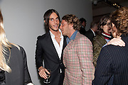 LAPO ELKANN; VLADIMIR RESTOIN ROITFELD;, Private view of the exhibition ' Mother of Pouacrus' by Nicholas Pol. Presented by Vladimir Restoin Roitfeld. The Old Dairy, Wakefield St.  London. 14 October 2010. <br /> <br /> -DO NOT ARCHIVE-© Copyright Photograph by Dafydd Jones. 248 Clapham Rd. London SW9 0PZ. Tel 0207 820 0771. www.dafjones.com.